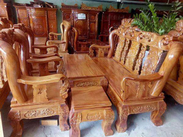 Bộ bàn ghế sa lông gỗ gõ đỏ tay 12 chạm đào SA005